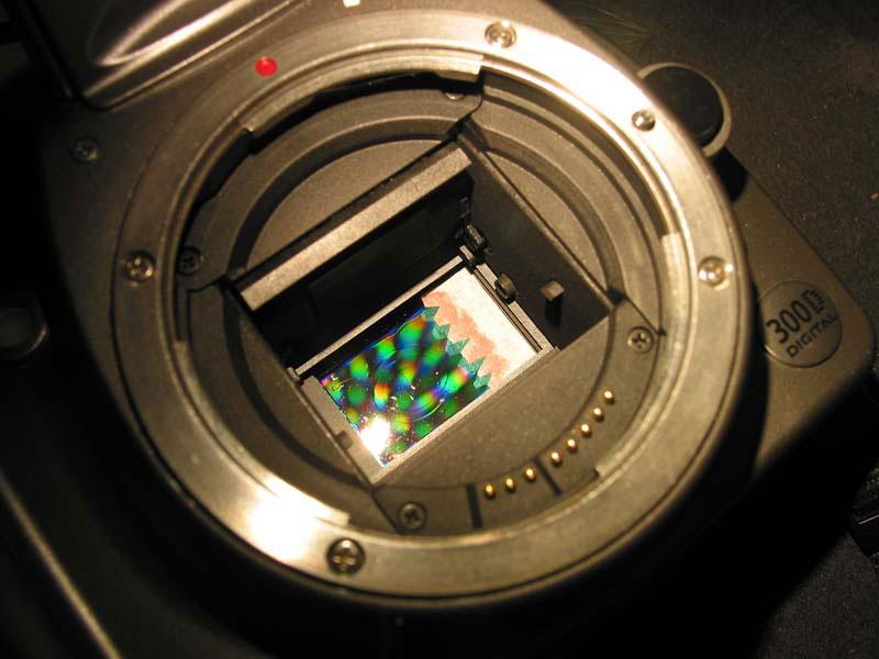 how to clean a spot off a camera sensor